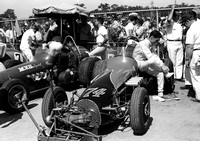 Ronnie Burke (MVS car in rear)  Hoosier 100  9-12-70